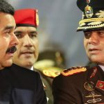 FILE - In this Oct. 27, 2014 file photo, Venezuela's President Nicolas Maduro, left, speaks with his Defense Minister Gen. Vladimir Padrino, during the new military chief's swearing-in ceremony at the Fort Tiuna military base in Caracas, Venezuela. Maduro on Monday, July 11, 2016 said he was creating a new government initiative to boost production and guarantee the smooth distribution of food supplies. He says that what is called the Great Mission of Sovereign Supplying will be headed Padrino, who will coordinate the work of every ministry. (AP Photo/Ariana Cubillos, File)