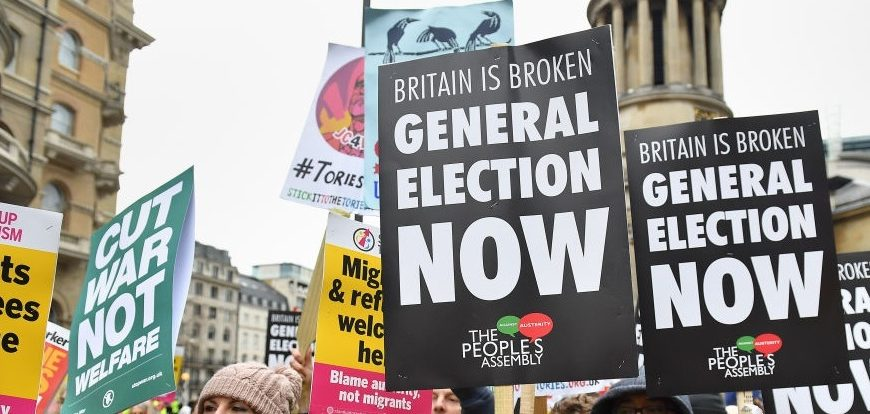 """Demonstrators at a People's Assembly Against Austerity """"yellow vest""""-inspired rally in central London calling for a general election. (Photo by Dominic Lipinski/PA Images via Getty Images)"""